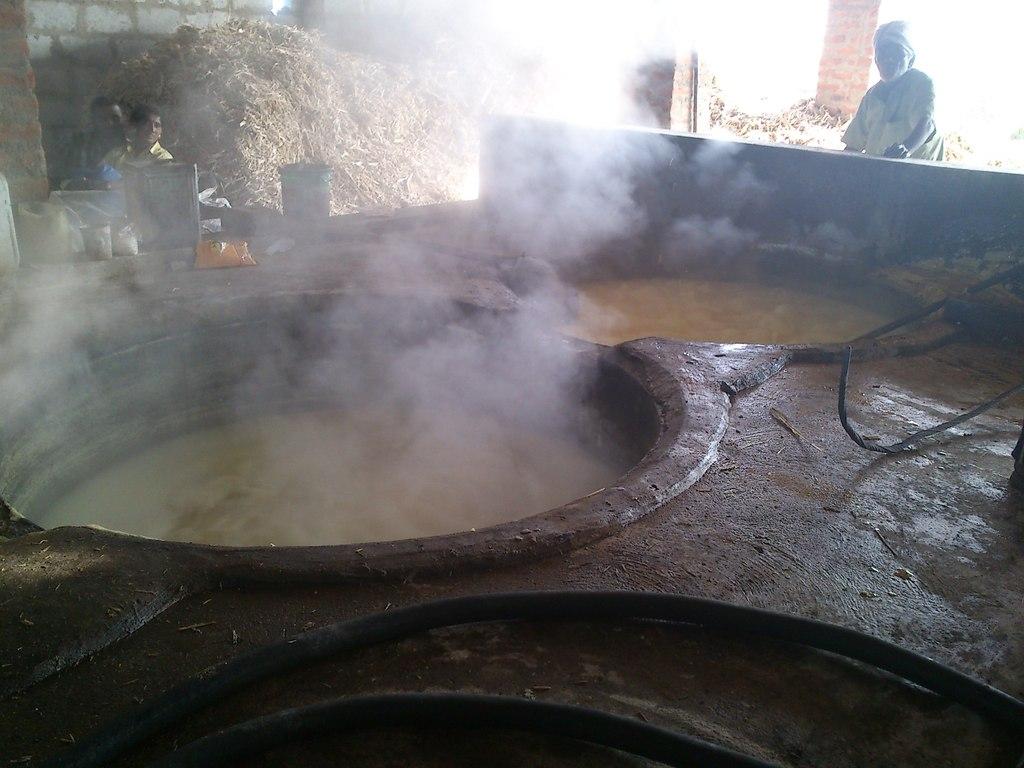 Sugarcane juice being boiled